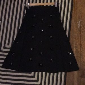 Black midi skirt with embellishments